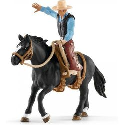 Kowboj siodłający dzikiego konia - Schleich