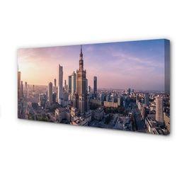 Obrazy na płótnie Warszawa Wschód słońca wieżowce panorama